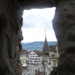 Peeking out the castle - I will eat at the outdoor street cafe' below on the right.