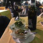Fresh olives and wine.