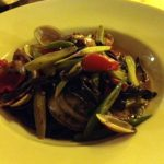 Squid ink tagliolini with clams.